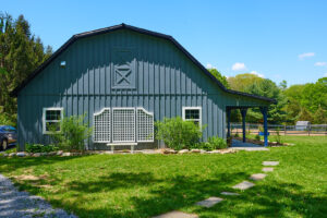 grey barn with farm store